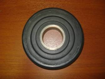 Escalator step traveler (the surface is rubber-bonded) To guarantee softness of the mechanism work the technology of rubber coat plating on a surface of a roller has been developed.